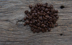 Coffee beans falling in white coffee cup.  Stock Photo