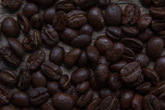 Coffee beans falling in white coffee cup.  Royalty Free Stock Photography