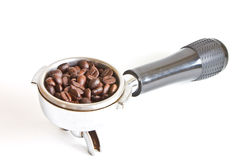 Coffee beans in filter holder Stock Photo