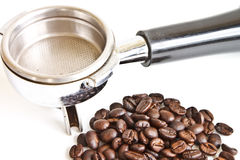 Coffee beans in filter holder Royalty Free Stock Image