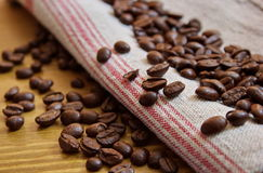 Coffee beans on flax tablecloth. Coffee beans on the flax tablecloth Royalty Free Stock Image