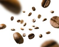 Coffee beans in flight on white background royalty free stock images