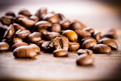 Coffee beans. With focus on one Royalty Free Stock Photo