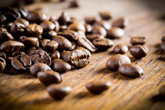 Coffee beans. Coffee beans with focus on one Royalty Free Stock Photos
