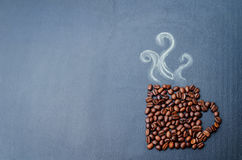 Coffee beans in the form of cup of coffee Royalty Free Stock Photo