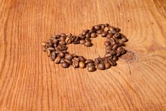 Coffee beans in the form of heart Stock Photos