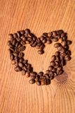 Coffee beans in the form of heart Royalty Free Stock Photos
