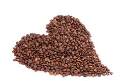 Coffee beans in a form of heart. Coffee break concept. Stock Photography