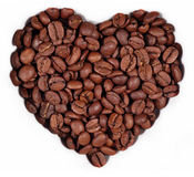 Coffee beans in the form of heart on a white Royalty Free Stock Photography