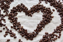 Coffee beans formed to heart Stock Images