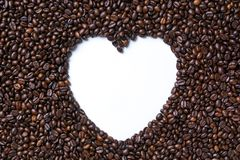 Coffee beans forming heart shaped on white background Stock Photography