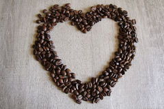 Coffee beans forming a heart on a table Stock Photo