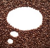 Coffee beans forming a thinking cloud frame. Over white background Royalty Free Stock Photos