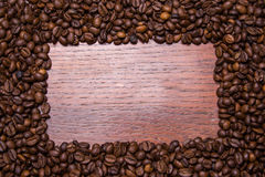 Coffee beans frame background on wood Royalty Free Stock Photos