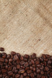 Coffee beans frame on burlap background Royalty Free Stock Images