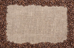 Coffee beans frame on burlap lighter. Roasted lighter coffee beans frame on burlap Royalty Free Stock Photography