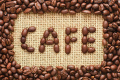 Coffee beans frame with cafe text on sacking Royalty Free Stock Images