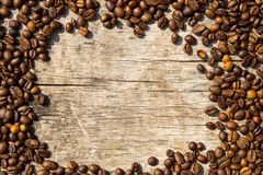 Coffee beans frame on grunge wooden background Stock Photography