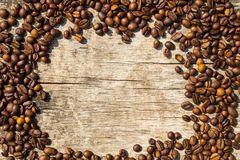 Coffee beans frame on grunge wooden background Royalty Free Stock Images