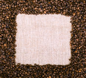 Coffee beans frame over burlap textile Royalty Free Stock Photos
