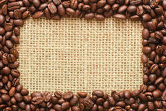Coffee beans frame on sacking Royalty Free Stock Photography