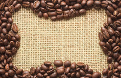 Coffee beans frame on sacking Royalty Free Stock Images