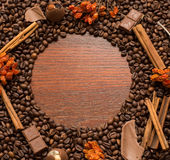 Coffee beans frame on wood wall Royalty Free Stock Image