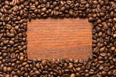 Coffee beans frame on wood wall Royalty Free Stock Photo