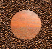 Coffee beans frame on wood wall Royalty Free Stock Photos