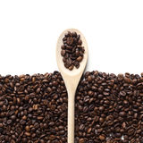Coffee beans background. Coffee beans frame with with a wooden spoon, copy space, isolated on white background. Top view Stock Photos