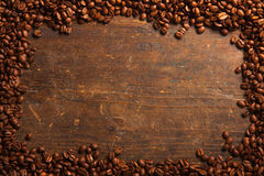 Coffee beans frame on wooden table Royalty Free Stock Photo
