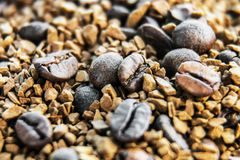 Coffee beans and freeze-dried coffee produce. Coffee beans and freeze-dried coffee background royalty free stock image