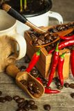 Coffee beans and fresh chili peppers. Trade in crops. Advertise for coffee shop. Stock Photography