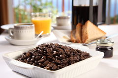 Coffee beans for a fresh cup at breakfast time Stock Photography