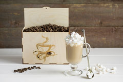 Coffee beans in a gift box. On a wooden background royalty free stock photography