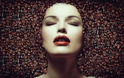Coffee beans. Girl in the coffee beans Royalty Free Stock Image