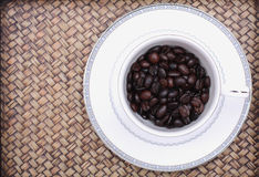 Coffee beans in a glass Royalty Free Stock Images