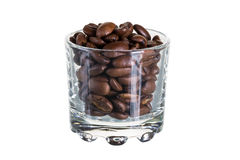 Coffee beans in a glass. Coffee beans in a beaker on a white background Royalty Free Stock Photos