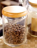 Coffee beans in the glass bottle Stock Photography