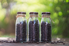 Coffee beans in glass bottle with selective focus point Royalty Free Stock Photo