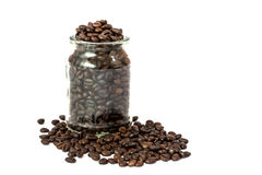 Coffee beans in glass bottle Stock Images