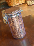 Coffee beans in glass container. Stock Image
