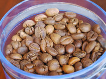 Coffee beans in glass container.Closeup. Royalty Free Stock Photos