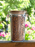 Coffee beans in glass container. Stock Photography