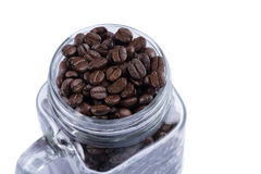 Coffee beans in glass cup. Coffee beans in glass on white background Royalty Free Stock Images