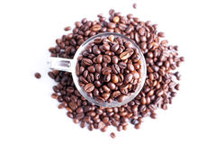 Coffee beans in a glass dish on a top view of the isolated white Royalty Free Stock Image