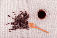 Coffee beans and a glass of espresso. Royalty Free Stock Image