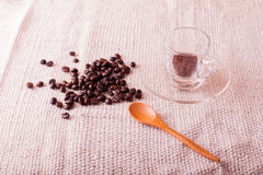 Coffee beans and a glass of espresso. Royalty Free Stock Photo
