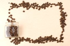 Coffee beans in glass jar as frame Stock Images