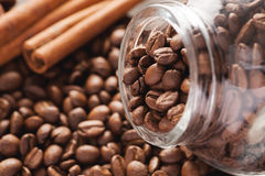 Coffee beans with glass jar and cinnamon Stock Photography